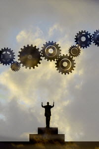 Conductor conducting cogs in sky