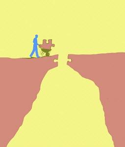 Man bringing last puzzle piece to bridge the gap