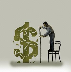 Man measuring crumbling dollar sign