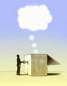 Man unlocking thought bubble from box