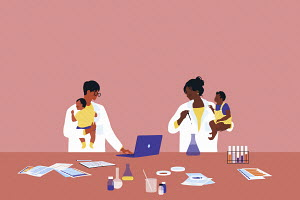Scientists working in laboratory holding babies