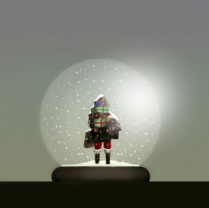 Father Christmas with pile of presents inside of snow globe