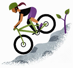 Woman mountain biking down steep slope