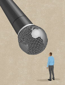 Man using large global microphone