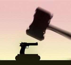 Handgun under judge's gavel