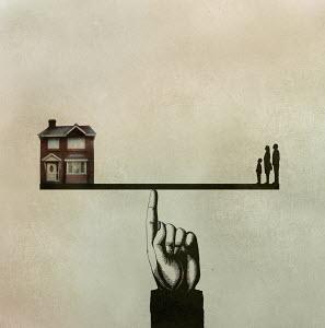 Family balanced on seesaw opposite house
