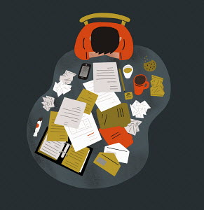 Overhead view of man struggling with paperwork