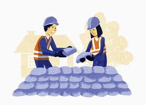 Worried couple building sandbag flood defence