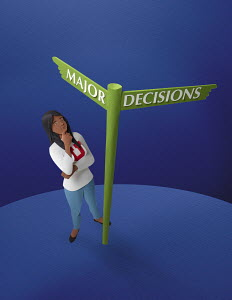 Student looking up at decision signpost