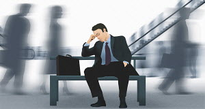 Exhausted businessman snoozing on platform bench in busy commuter railway station