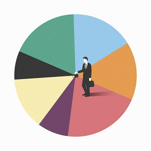 Businessman with torch beam on pie chart