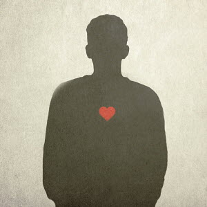 Red heart on silhouette of man