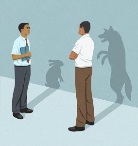 Businessmen with rabbit and wolf shadows