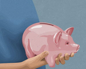 Hands holding piggy bank