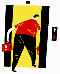 Businessman going down in lift
