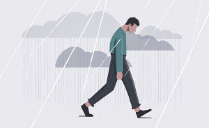 Depressed man walking in rain