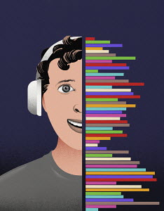 Teenage boy listening to music on headphones from multi coloured sound waves