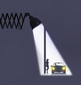Spotlight on man in car propositioning prostitute