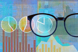 Pair of glasses examining financial data