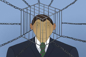 Businessman with head trapped inside of cage