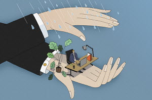 Hands sheltering businessman from rain