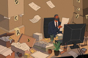 Overworked businessman with piles of paper