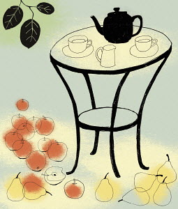 Tea on table surrounded by apples and pears