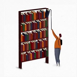 Man reaching to get book from top shelf