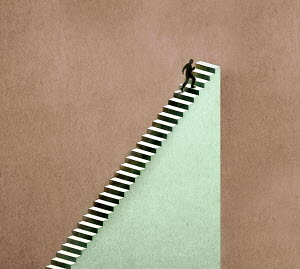 Man reaching the end of the staircase