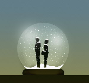 Couple with relationship problems inside snow globe