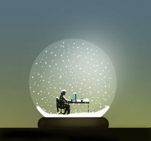 Businesswoman working at desk inside of snow globe