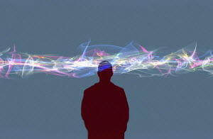 Man's head in swirling cloud of multi coloured light