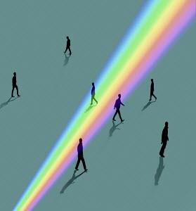 Silhouettes of people walking through rainbow light