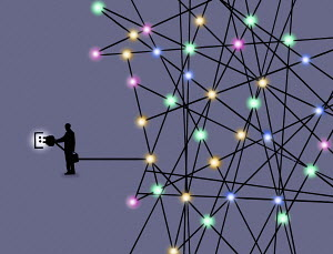 Businessman plugging in network of lights