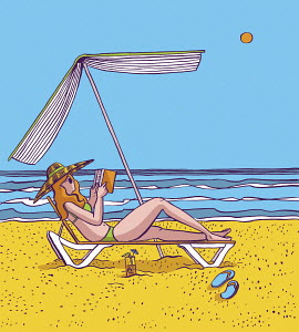 Woman reading under book parasol on beach