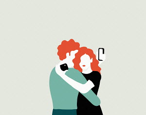 Couple taking selfies while embracing