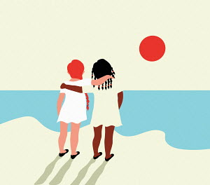 Two little girls with arms around each other looking out to sea