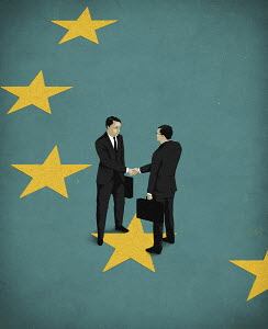 Businessmen shaking hands on European Union flag