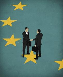 Businessmen shaking hands on European Union flag