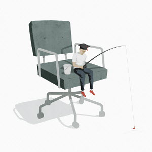 Small graduate fishing sitting on oversized office chair