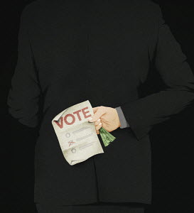 Man clutching banknote and voting ballot paper