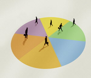 Businessmen walking across pie chart
