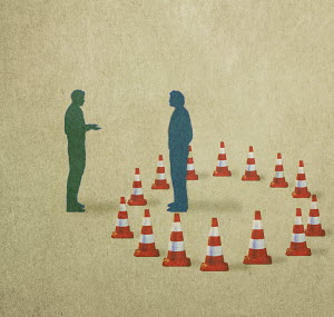 Traffic cones separating men having conversation