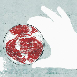 Hand holding petri dish containing raw meat