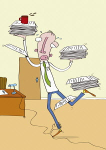 Businessman struggling with piles of paperwork