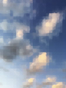 Pixelated clouds in blue sky