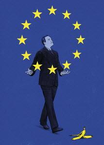 Businessman juggling European Union flag stars about to slip on banana skin