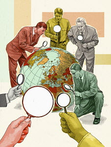 Group of businessmen looking at globe through magnifying glass