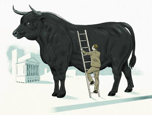 Businessman climbing ladder against large bull