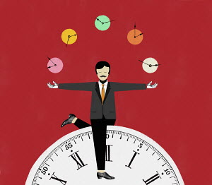 Businessman juggling clocks